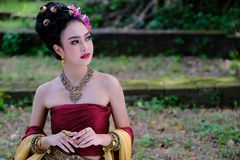Beautiful Thai girl in traditional dress costume in Choeng Tha a. S Thai temple where is the public place, Thai Woman in Traditional Costume of Thailand royalty free stock photos