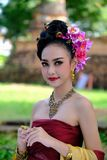 Beautiful Thai girl in traditional dress costume in Choeng Tha a. S Thai temple where is the public place, Thai Woman in Traditional Costume of Thailand stock image