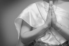 Beautiful Thai girl in traditional dress costume,press the hands together at the chest. Black and white tone royalty free stock images