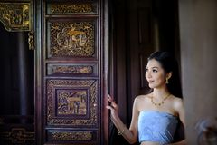Beautiful Thai girl in traditional dress costume in Thai temple. Where is the public place stock image