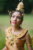 Beautiful Thai lady in Thai traditional drama dress. Posing in the forest, greenery in the background, model is Thai Ethnicity Stock Images