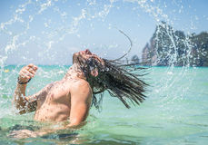 Beautiful thai  landscape  with man splashing water Royalty Free Stock Photography