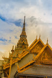 Beautiful Thai's style craving and decoration on the golden gabl. E end at Wat Sothonwararam, a famous public temple in Chachoengsao Province, Thailand Stock Photo