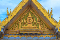 Beautiful Thai's style craving and decoration on the golden gabl. E end at Wat Sothonwararam, a famous public temple in Chachoengsao Province, Thailand Royalty Free Stock Images