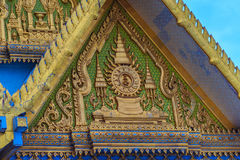 Beautiful Thai's style craving and decoration on the golden gabl. E end at Wat Sothonwararam, a famous public temple in Chachoengsao Province, Thailand Royalty Free Stock Image
