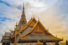 Beautiful Thai's style craving and decoration on the golden gabl. E end at Wat Sothonwararam, a famous public temple in Chachoengsao Province, Thailand Royalty Free Stock Photo