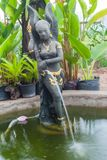 A beautiful Thai-style fairy statue standing in a pool of home g. Arden Stock Images