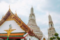 Beautiful Thai style temple roof with a view of pagoda at Wat Arun. Bangkok, Thailand. stock image