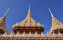 Beautiful Thai temple roof soaring into blue sky Stock Photos
