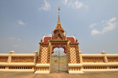 Beautiful Thai temple arched entrance. The beautiful Thai Buddhism temple and arched entrance which made of golden color  stuccowork with the mirror Stock Photography