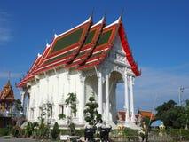 Beautiful Thai temple soars into blue sky Stock Photos