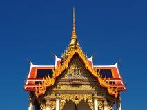 Beautiful Thai temple Wat Thepnimit soars into blue sky Stock Photos