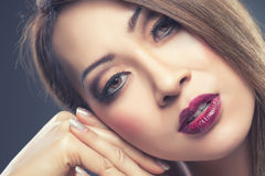 Beautiful Thai woman with makeup and nails done Stock Photos