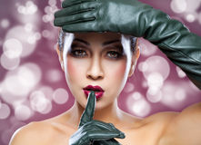 Beautiful Thai woman wearing leather gloves Stock Photos