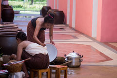Beautiful Thai women in Thai traditional style preparing cooking. Royalty Free Stock Images
