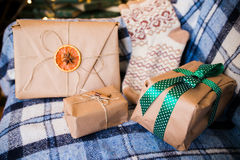 Beautiful themed gifts lie on vintage chair christmas Stock Image