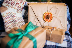 Beautiful themed gifts lie on vintage chair christmas Royalty Free Stock Photography