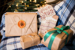 Beautiful themed gifts lie on vintage chair christmas Stock Images