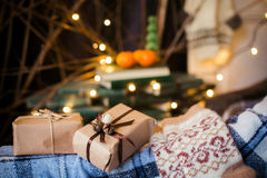 Beautiful themed gifts lie on vintage chair christmas Royalty Free Stock Image
