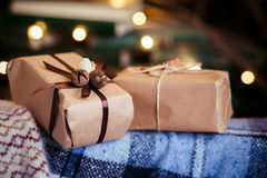 Beautiful themed gifts lie on vintage chair christmas Royalty Free Stock Images