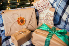 Beautiful themed gifts lie on vintage christmas chair Stock Photography