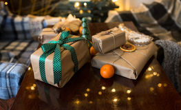 Beautiful themed gifts lie on wooden table. Green ribbon royalty free stock images