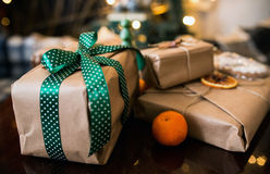 Beautiful themed gifts lie on wooden table Stock Images