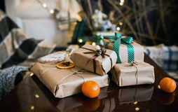 Beautiful themed gifts lie on wooden table Stock Photo