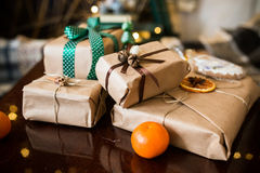 Beautiful themed gifts lie on wooden table. Green ribbon stock image