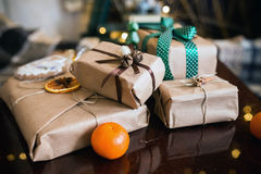Beautiful themed gifts lie on wooden table Stock Image