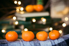 Beautiful themed tangerines lie on vintage chair christmas. Beautiful themed tangerines lie on vintage chair royalty free stock images