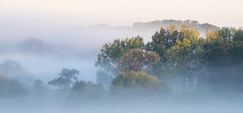 Beautiful thick fog sunrise Autumn Fall countryside landscape wi Stock Photo