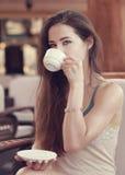 Beautiful thinking girl drinking Stock Photos