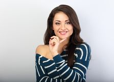 Beautiful thinking natural toothy smiling woman looking royalty free stock photo