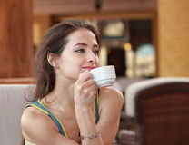 Beautiful thinking woman drinking Royalty Free Stock Photography