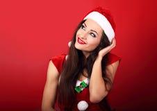 Beautiful thinking woman in santa claus christmas costume lookin Royalty Free Stock Photos