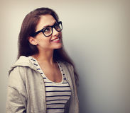 Beautiful thinking young woman in glasses looking up. Vintage po Stock Images