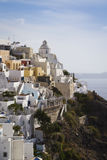 Beautiful Thira, Santorini. The village of Thira climbs on the side of a cliff above the caldera on Santorini, Greece Royalty Free Stock Photography