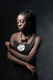 Beautiful  thoughtful Black woman with an ethnic necklace Royalty Free Stock Photos