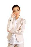 Beautiful thoughtful businesswoman. Royalty Free Stock Image