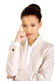 Beautiful thoughtful businesswoman. Stock Photos