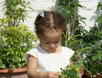 Beautiful thoughtful,child with flowers Stock Images