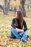 Beautiful thoughtful girl  in autumn Stock Photo