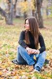 Beautiful thoughtful girl  in autumn Stock Photo