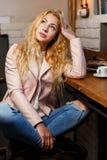 Beautiful thoughtful girl in cafe Stock Photo