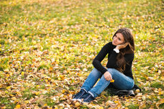 Beautiful thoughtful girl  in park Royalty Free Stock Images
