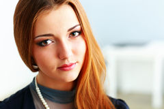 Beautiful thoughtful redhead woman Royalty Free Stock Images