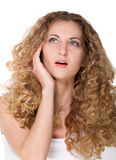 Beautiful thoughtful woman looking up. Beautiful thoughtful blond woman looking up. Isolated over white Royalty Free Stock Photos