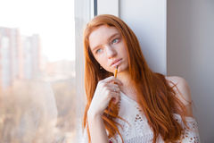Free Beautiful Thoughtful Woman With Pencil Dreaming Near Window Stock Image - 64031191