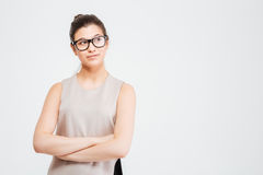 Beautiful thoughtful young business woman standing with arms crossed Royalty Free Stock Photo